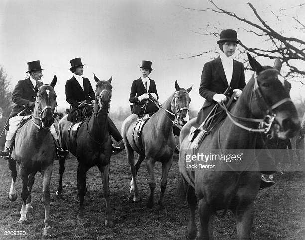 Princess Mary of England rides a horse with Major Fawkes and Mrs Ed Lascelles at the Bramham Moor Meet in East Keswick England