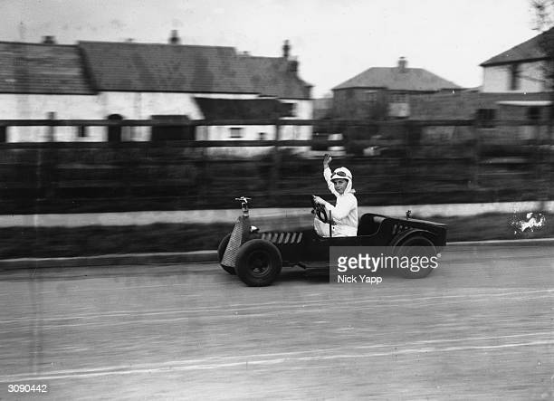 A miniature motor with a 4 stroke engine of 2 horsepower made for lucky nine year old Arthur Tweedle of Poulton Blackpool by his father The vehicle...