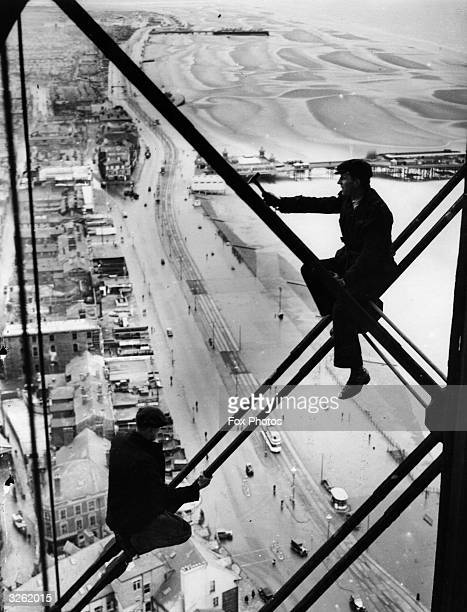 Men 500 ft up Blackpool Tower where repairs are being carried out The promenade and beach are clearly visible below