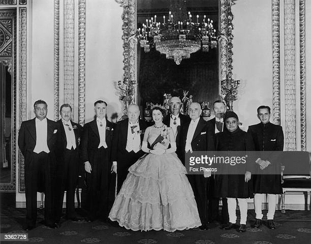 Queen Elizabeth II stands in the Throne Room of Buckingham Palace with seven Commonwealth premiers and two finance ministers during the Economies...