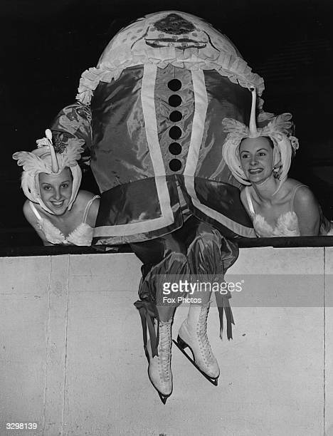 Ice skaters Trixie Moss and Beryl Smith with 'Humpty Dumpty' at the Empire Pool Wembley