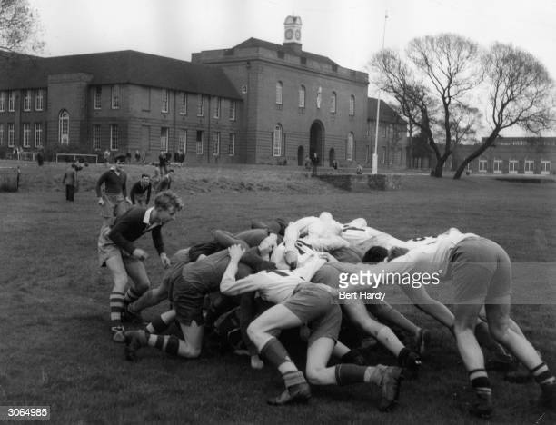 Schoolboys playing rugby union at Manchester Grammar School Original Publication Picture Post 7424 The Education Money Can't Buy pub1954