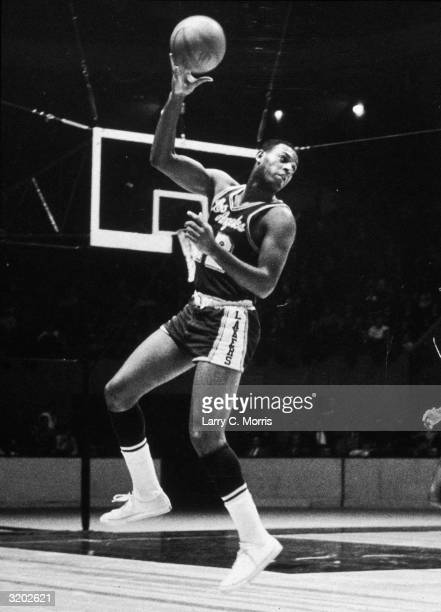 Fulllength image of Los Angeles Lakers basketball player Elgin Baylor preparing to make a long overtheshoulder pass during an NBA game against the...