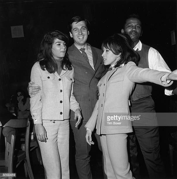 American singers and musicians Nedra Talley and Veronica 'Ronnie' Bennett of the rock and roll group The Ronettes standing with television dance...
