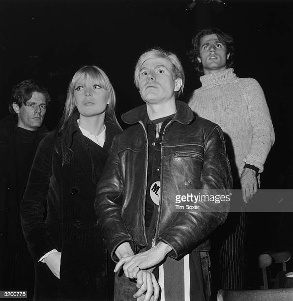 Left to right Director Paul Morrissey singer Nico artist Andy Warhol and poet Gerard Malanga attend a 'Freakout' party featuring a Velvet Underground...