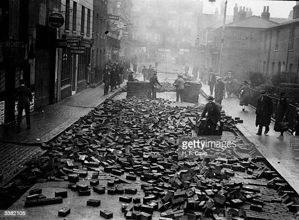 Uprooted bricks in Dalling Road, Hammersmith, west London, after a water main burst.