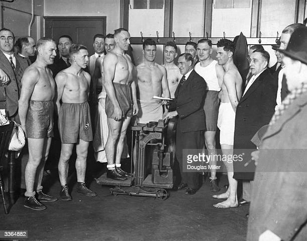 German police boxers weighing in at Scotland Yard London for their fights at the Metropolitan Police Boxing Championships at the Royal Albert Hall