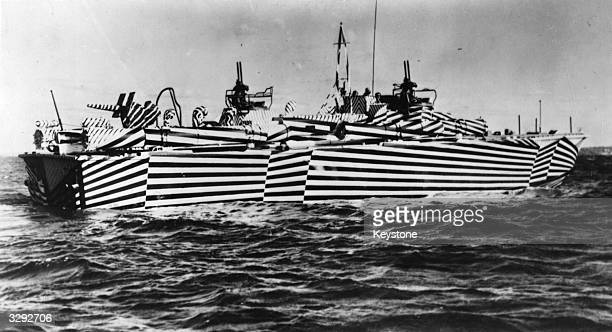A US Navy Patrol Torpedo boat with a unique zebra stripe camouflage designed to confuse the enemy as to the vessel's course