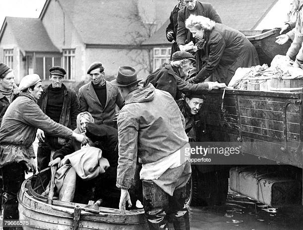 4th February 1953 One of the most dramatic of the flooded Canvey Island rescues as 84 years old Miss Fowler is carried from her house here where she...