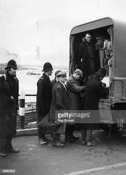 Police search a van leaving Canvey Island on the Thames Estuary as a precaution against possible looting Canvey Island was a popular landing point...