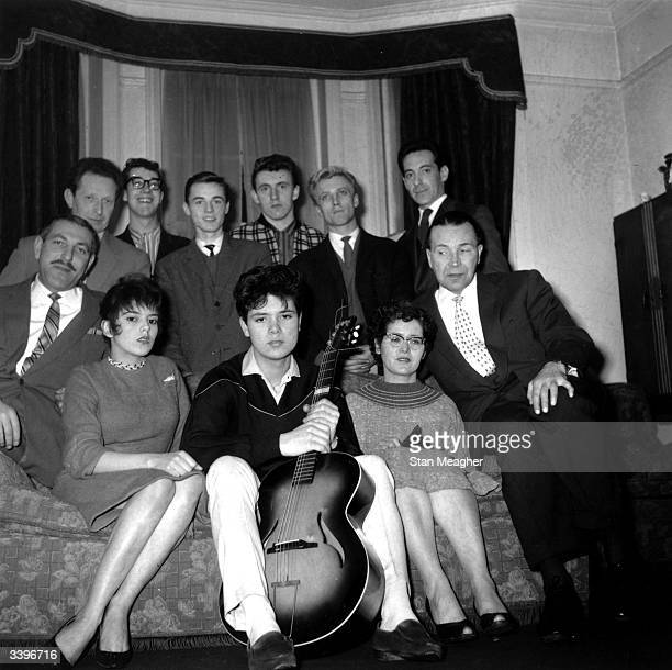 British pop singer Cliff Richard and The Shadows Clockwise from rear left Joe Lee Hank Marvin Tony Meehan Bruce Welch Jet Harris Len Saxon Tito Burns...