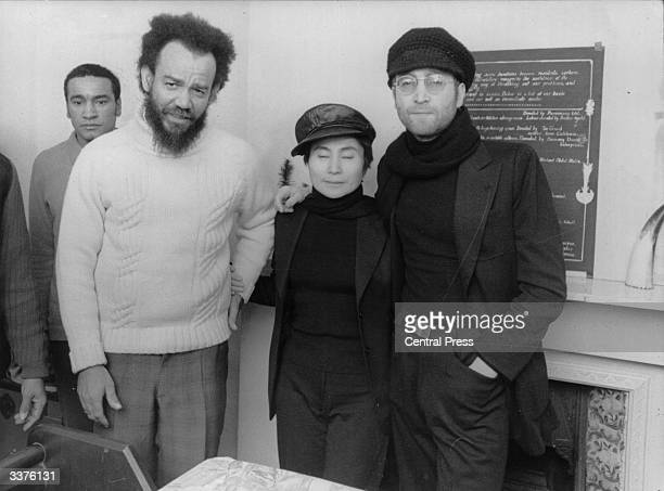 ExBeatle pop star John Lennon and his wife artist Yoko Ono with black power leader Michael X at his house in Holloway