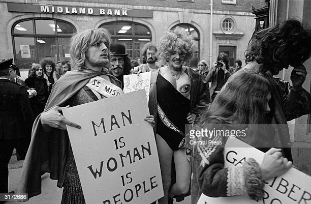 Members of the Gay Liberation Front protesting outside Bow Street Magistrates Court where five members of the Women's Liberation Front are appearing...