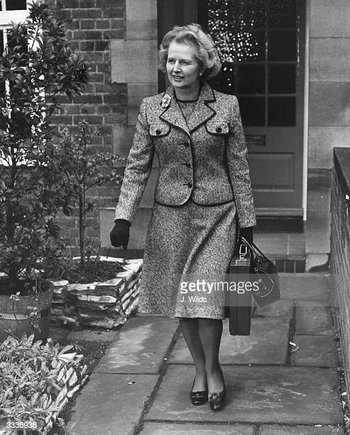 British politician Margaret Thatcher leaving her Chelsea home to attend the first ballot in the election for the leadership of the Conservative party