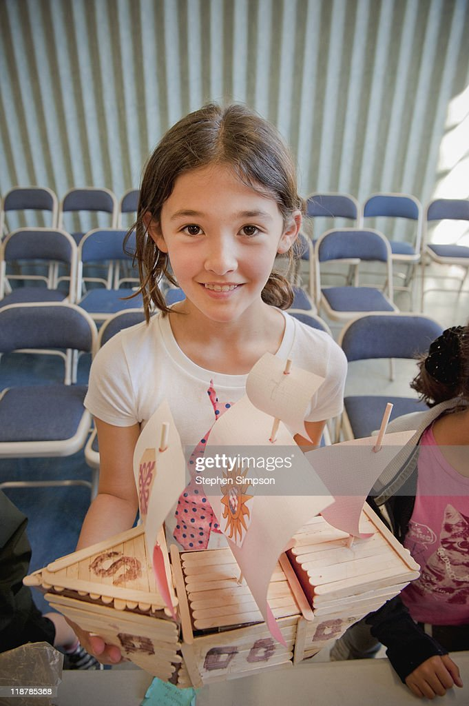 4th grade girl and her hand-made galleon : Stock Photo