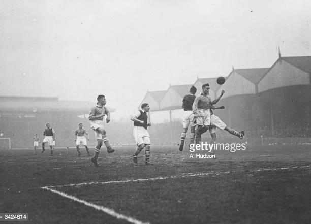 Arsenal's Joe Hulme heads for the goal during their match against Birmingham at Highbury