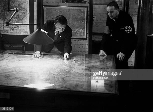 A plan of the factories engaged in 'roof watching' where observers were posted on factory roofs which acted as observation posts At the first sign of...