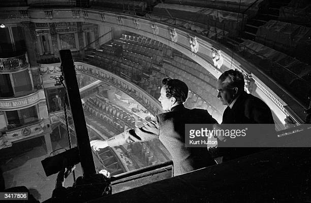 Gladys Calthrop the set and costume designer for Noel Coward's production of 'Pacific 1860' checks her work from the kind of views that the paying...