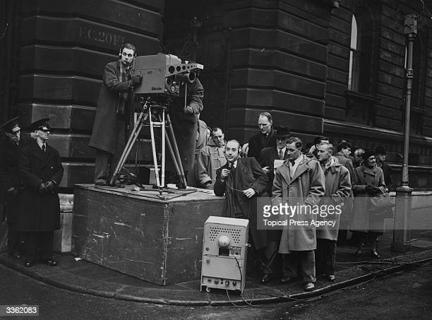 Camera crew awaiting the arrival of dignitaries to Downing street, London.