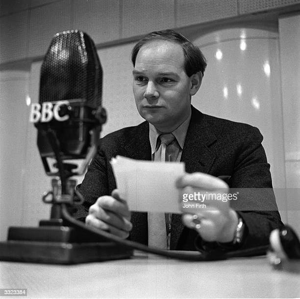 BBC Radio presenter Cliff Michelmore reads a request during a recording of 'Housewife's Choice' a popular music programme with over six million...
