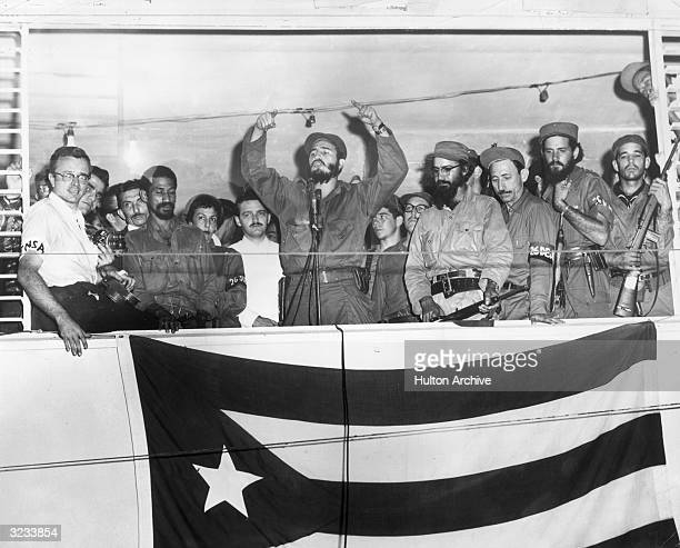 Cuban President Fidel Castro speaking from a podium to the people of Camaguey Cuba about the Triumph of the Cuban Revolution three days before...