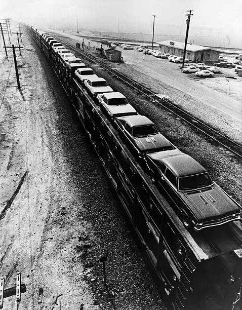 A 'unit train' over a mile long, carrying 100 General...