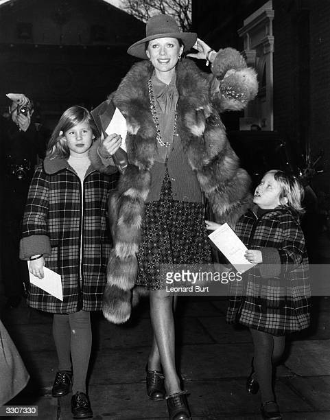 Paulene Stone widow of Laurence Harvey with their children Sophie and Domino after attending the memorial service at St Paul's in Covent Garden for...