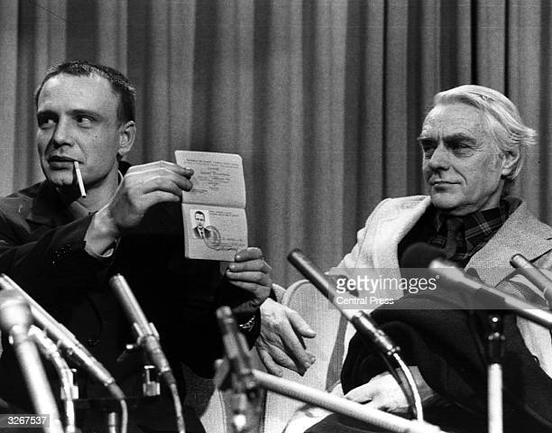 Vladimir Bukovsky the Russian dissident recently freed by Soviet authorities holds up his Russian passport as he faces questions from the Press...
