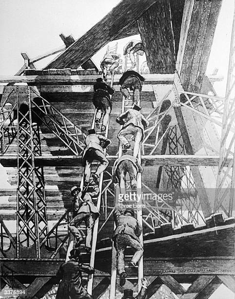Men of the press climb 450 ft up to the completed second level of the Eiffel Tower under construction for the Paris Exhibition of 1889