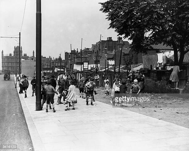 Children playing on New Dockland Road near the slum housing of Canning Town East London