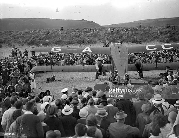 A crowd gathers to see recordholding British aviators husband and wife team Amy Johnson and James Mollison at Pendine Carmarthenshire in southwest...