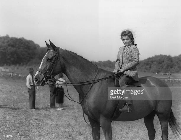 Portrait of Jacqueline Bouvier , daughter of Mr and Mrs John V Bouvier III, mounted on her horse, 'Danseuse,' South Hampton, Long Island, New York