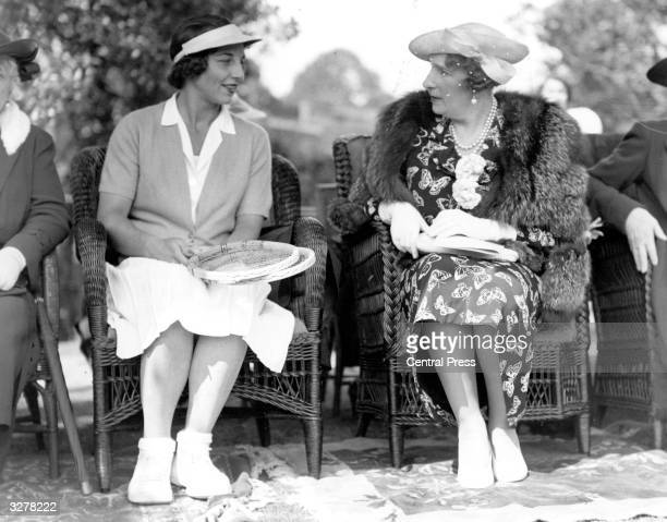 Helen Wills Moody American tennis player and eight times Wimbledon Ladies Champion taking tea with Queen Victoria of Spain at a tennis party in...