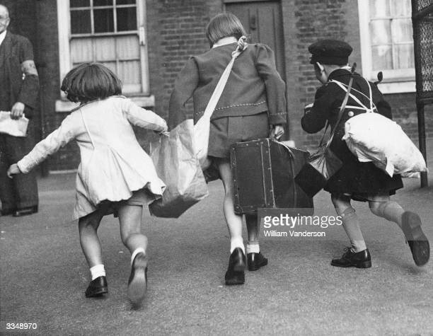 Three evacuees from Islington London make a dash for the train which will take them to the country during the Second World War