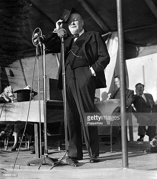 4th July 1945 Walthamstow London British Prime Minister Winston Churchill protects his eyes from the sunshine as he makes an election speech at the...
