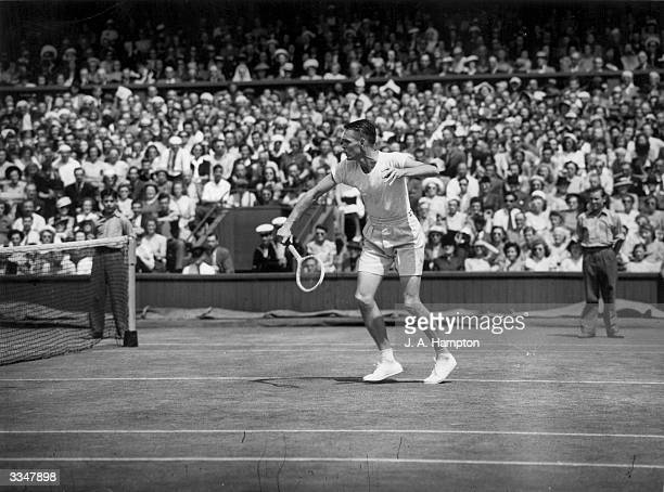 American tennis player Jack Kramer hits a backhand shot on his way to beating fellow American Tom Brown in the men's singles final at Wimbledon.