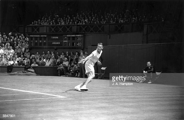 American tennis player Jack Kramer in action on his way to beating fellow American Tom Brown in the men's singles final at Wimbledon.