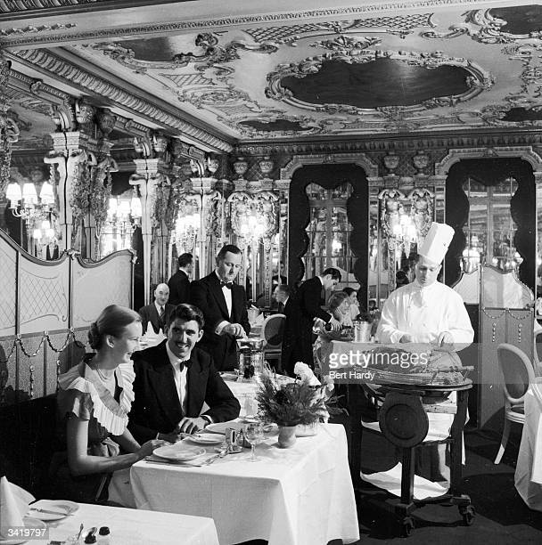 A couple eating in the Cafe Royal in Piccadilly London Original Publication Picture Post 6576 Known Your Piccadilly pub 1953