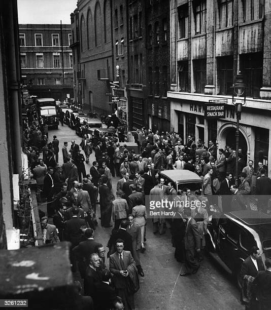 Archer Street London has become the dance band exchange On Mondays the pavements are crowded with men making arrangements and engagements for the...