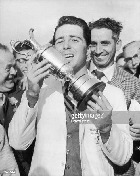 South African golfer Gary Player holds his trophy aloft after winning the British Open at Muirfield in Scotland