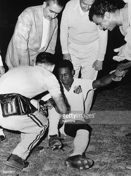 Brazilian footballer Pele receiving treatment during a game between Santos and Panathinaikos in Athens
