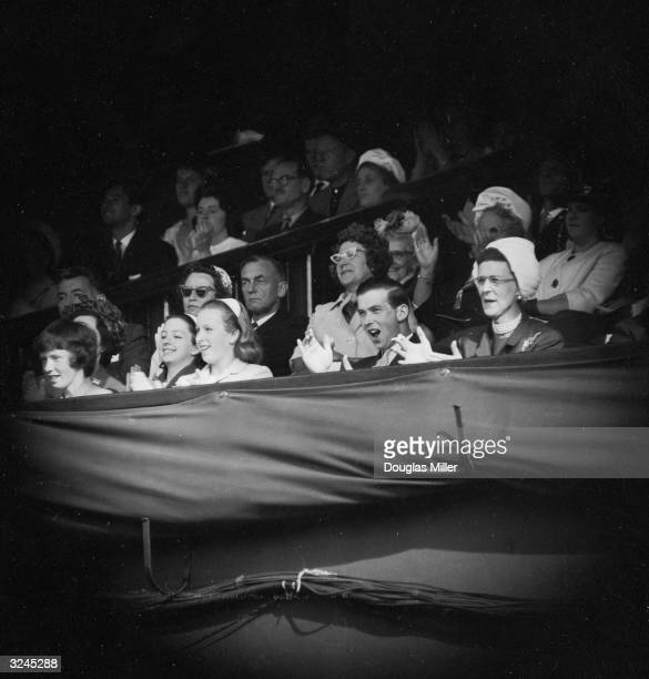 From left to right Princess Anne Prince Michael of Kent and his mother Princess Marina show their approval from the royal box at Wimbledon