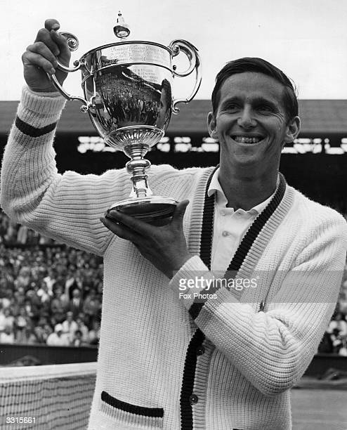 Australian tennis player Roy Emerson holds up the men's singles trophy at Wimbledon