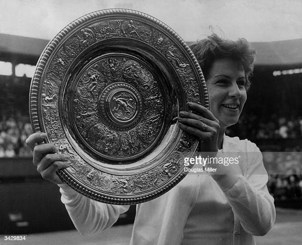 Marion Bueno of Brazil with the Women's Singles Championship trophy which she won at Wimbledon by beating Australian Margaret Smith