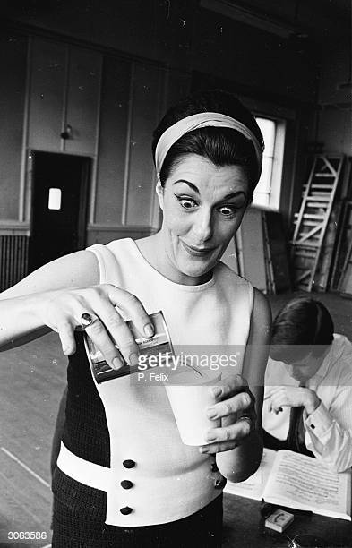 Australianborn soprano Marie Collier pours herself a drink during a rehearsal at Sadler's Wells in London