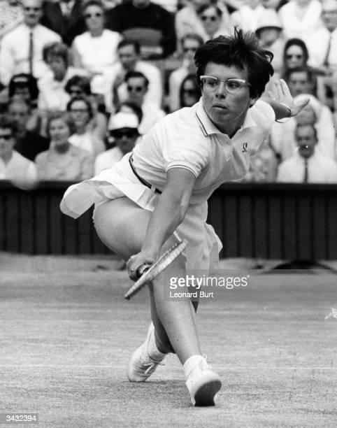 American tennis player Billie Jean King makes a powerful backhand during her semifinal match against Ann Jones at the Wimbledon Lawn Tennis...