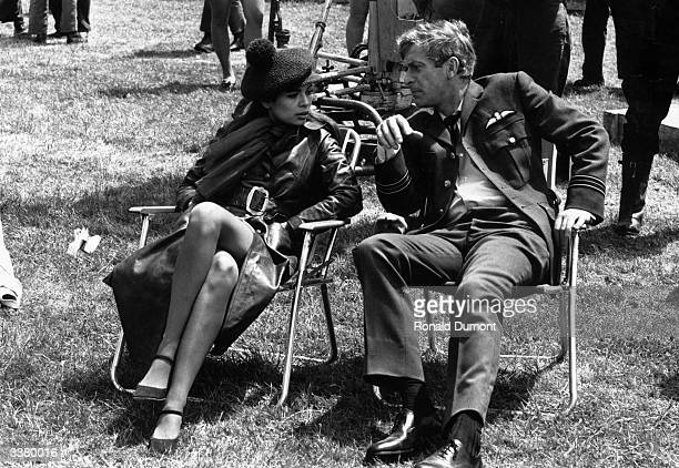 English film actor Michael Caine and Bianca de Macias during a break in filming Guy Hamilton's 'Battle of Britain' on location at RAF Hawkinge Kent