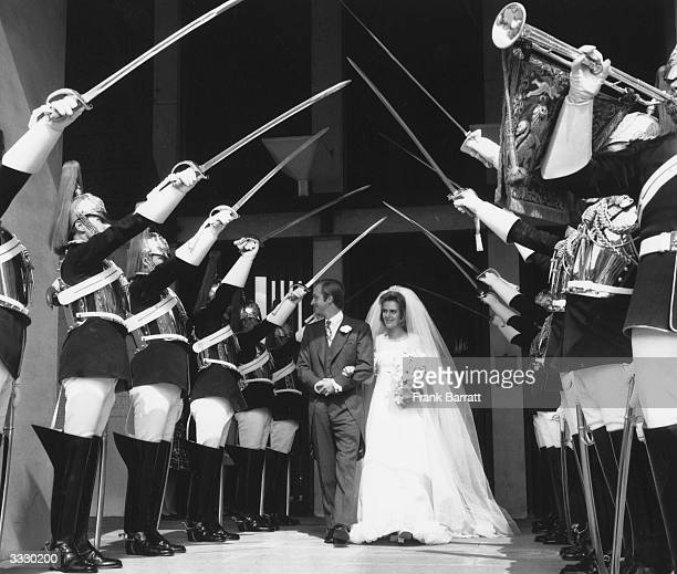 Camilla Shand and Captain Andrew ParkerBowles leaving the Guards Chapel under a guard of honour on their wedding day