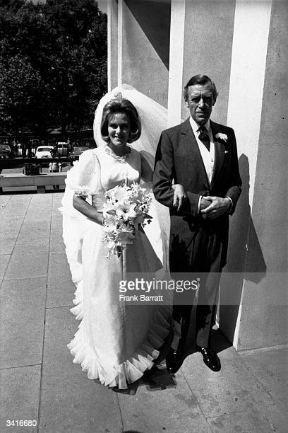 Camilla Shand arrives at the Guard's Chapel for her wedding to Andrew ParkerBowles on the arm of her father Major Bruce Shand