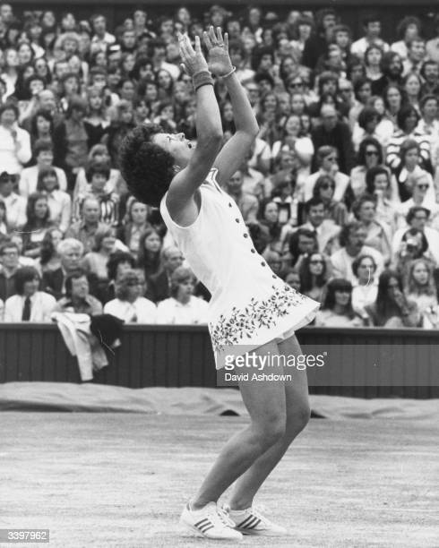 Victorious American tennis player Billie Jean King celebrating her sixth Wimbledon singles title which she won against Australian Evonne Cawley